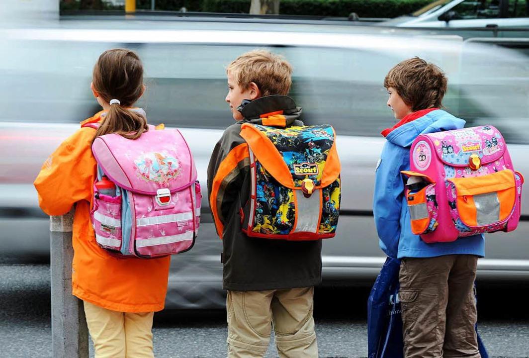 Kinder auf dem Weg zur Schule (Symbolbild)  | Foto: dpa