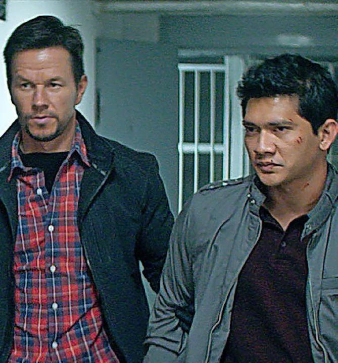 Mark Wahlberg (li.)  und Iko Uwais  | Foto: dpa