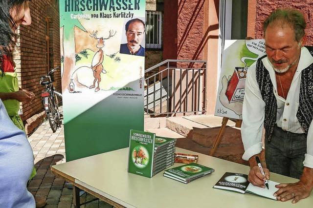 Klaus Karlitzky zeigt Karikaturen