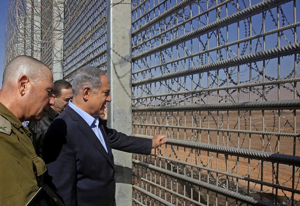 Der israelische Premier Benjamin Netan...Nationalitäten-Gesetzes in der Kritik.  | Foto: Marc Israel Sellem / Pool