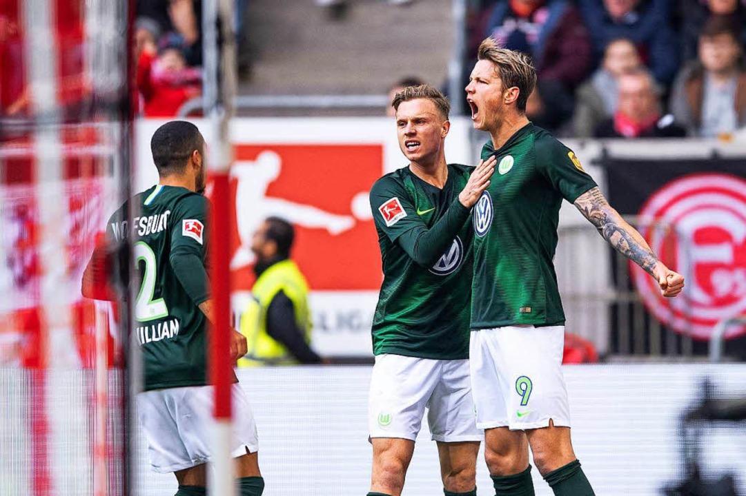 Wolfsburgs William de Asevedo Furtado ...0 Führung beim Spiel gegen Düsseldorf.  | Foto: dpa