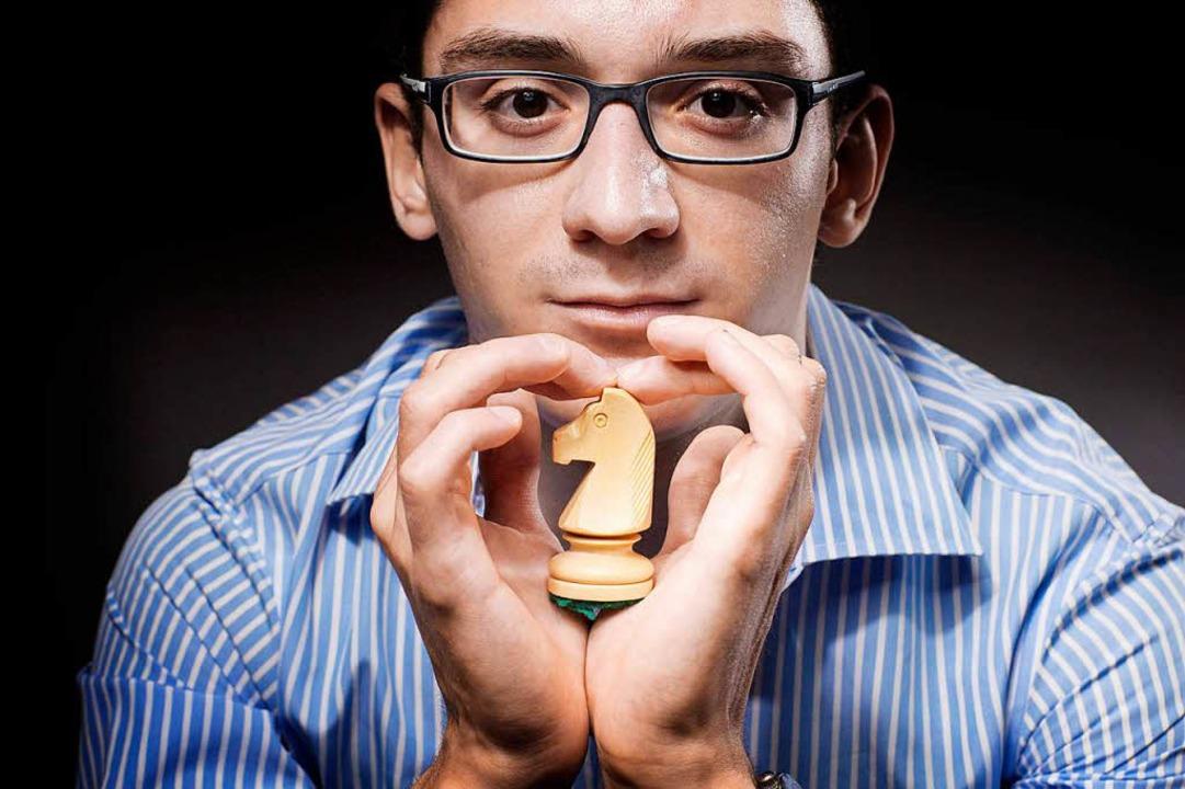 Der US-Amerikaner Fabiano Caruana künd...an. Für ihn ist Schach ein Kampfsport.  | Foto: AFP