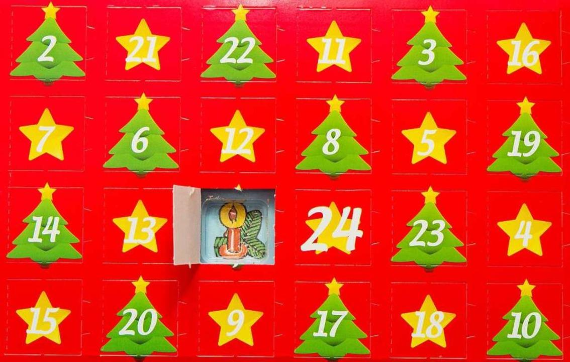 24 kleine Türchen bis Weihnachten &#82...und für eine besinnliche Zeit sorgen.   | Foto: dpa