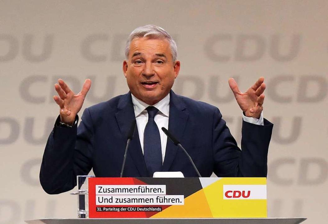 Der CDU-Landesvorsitzende von Baden-Wü...n CDU-Vorsitzenden zu den Delegierten.  | Foto: dpa