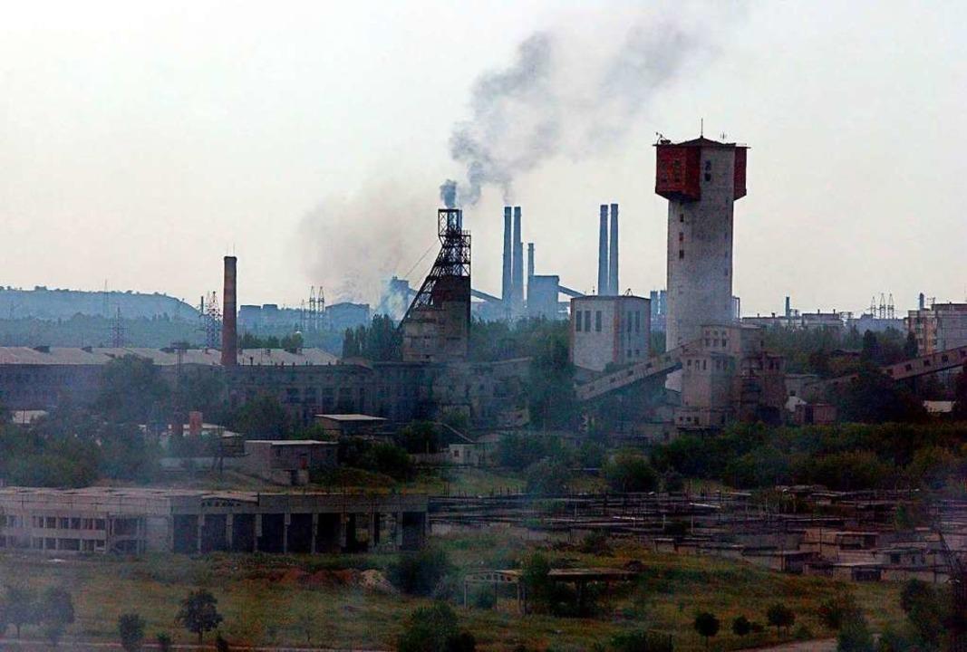 Wegen steigenden Wassers in den Minen ...s droht eine ökologische Katastrophe.   | Foto: DPA