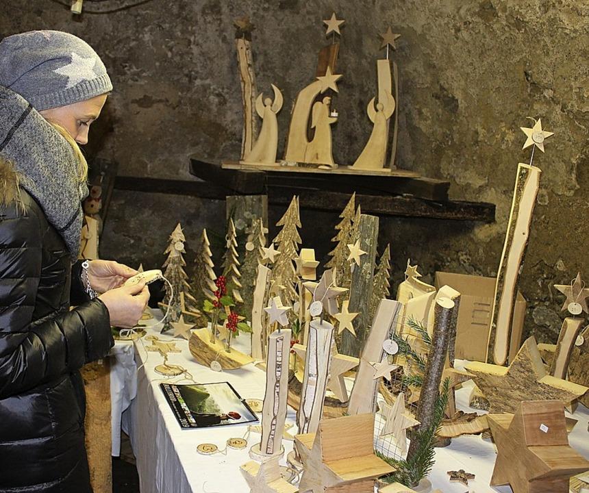 Weihnachtsmarkt auf dem Wisdishof (von...Stein und Konstantin Suratny (v.li.).   | Foto: Karin Heiss