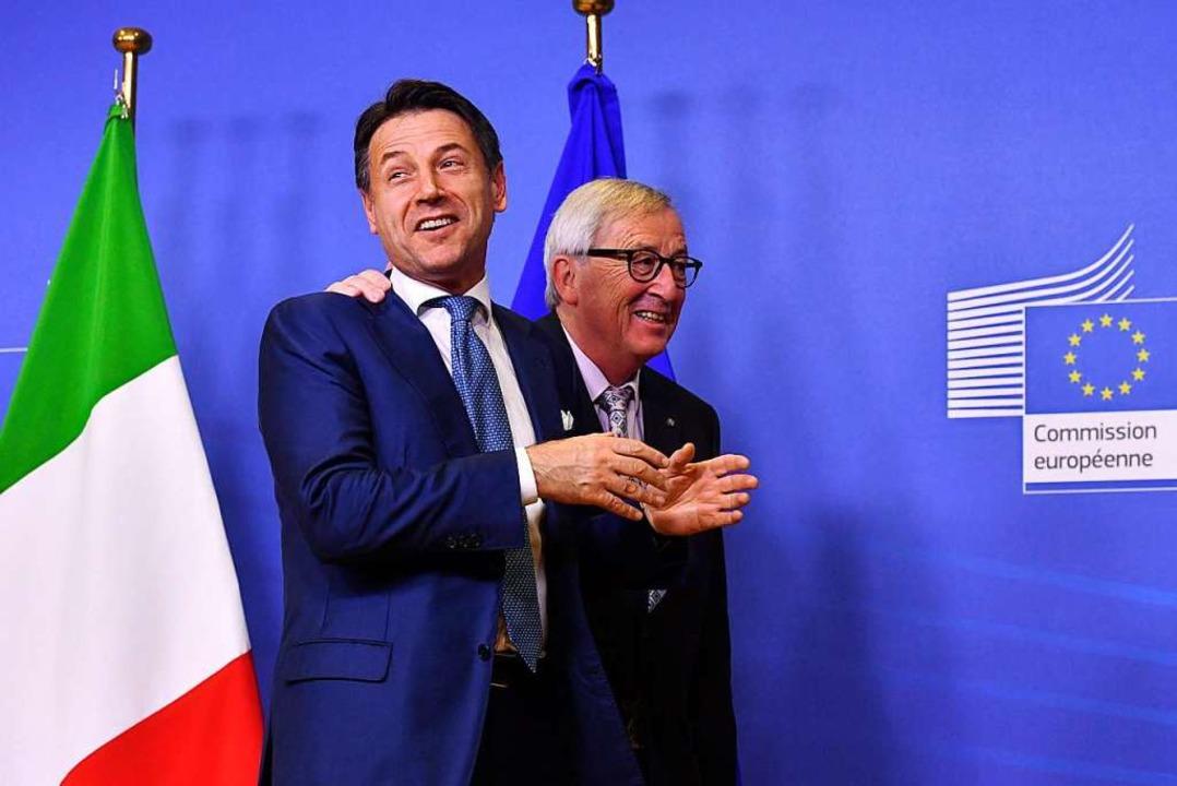 Noch mal gut gegangen: Italiens Premie...mmissionspräsident Jean-Claude Juncker  | Foto: dpa