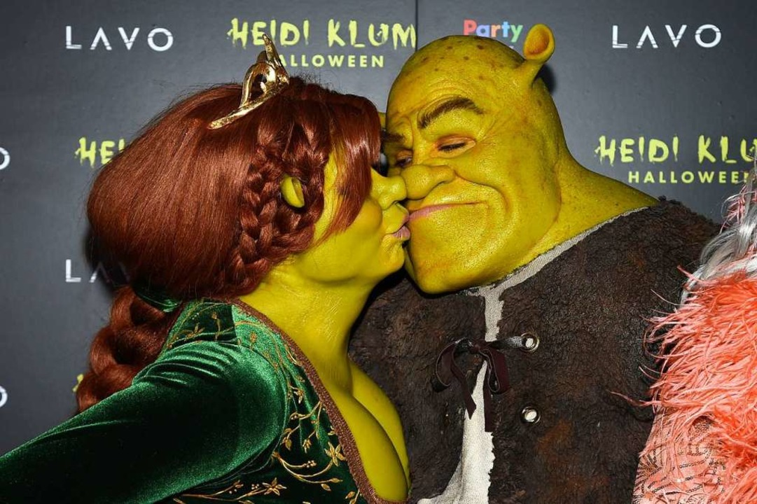 Shrek und Fiona – alias Heidi Kl...itz – auf Klums Halloween-Party.    Foto: dpa