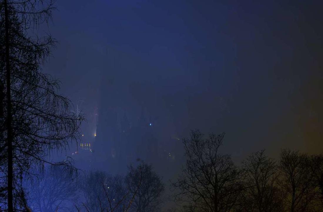 Um Viertel nach zwölf lichtete sich der Schleier um das Münster wieder.    Foto: Marius Koenig