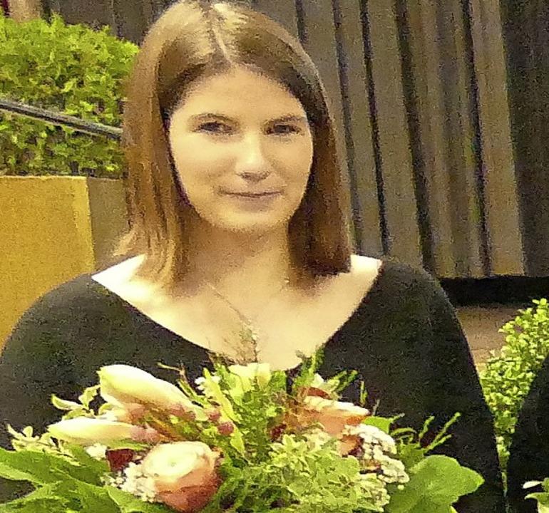 Blumen  gab's von  Oliver Friebo...Badmintontalent Doreen van der Hoofd.   | Foto: Langelott