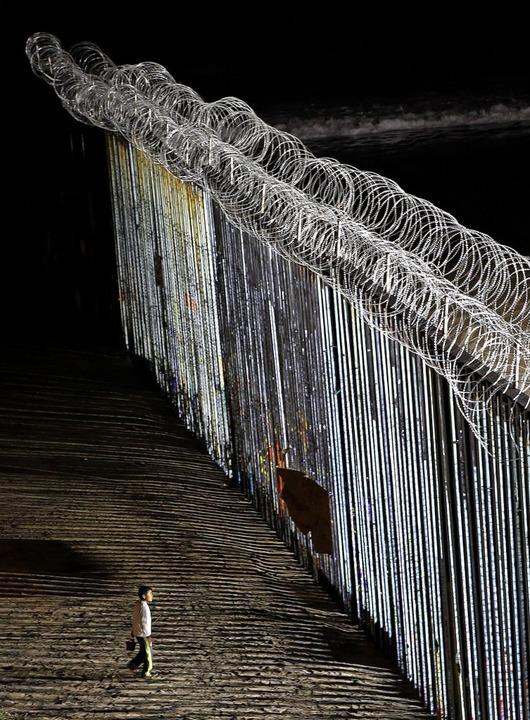 Metallzaun an der Grenze zwischen den USA und Mexiko    Foto: DPA/AFP