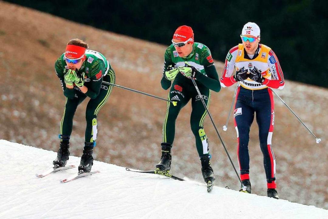 Rasant vorneweg: Fabian Rießle (links)...ergen Graabak (rechts) nur Rang drei.   | Foto: dpa