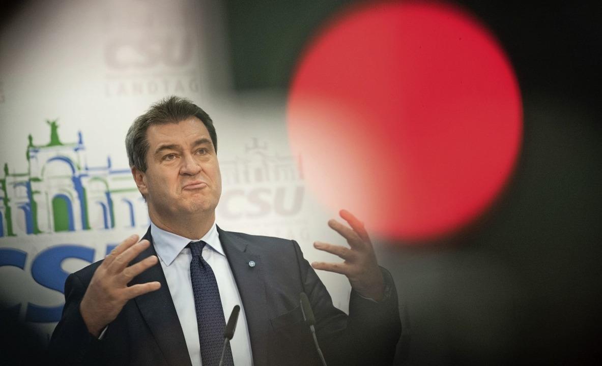 Ist auf einmal gar nicht mehr krawalli...t auf die Grünen-Wähler: Markus Söder   | Foto: dpa