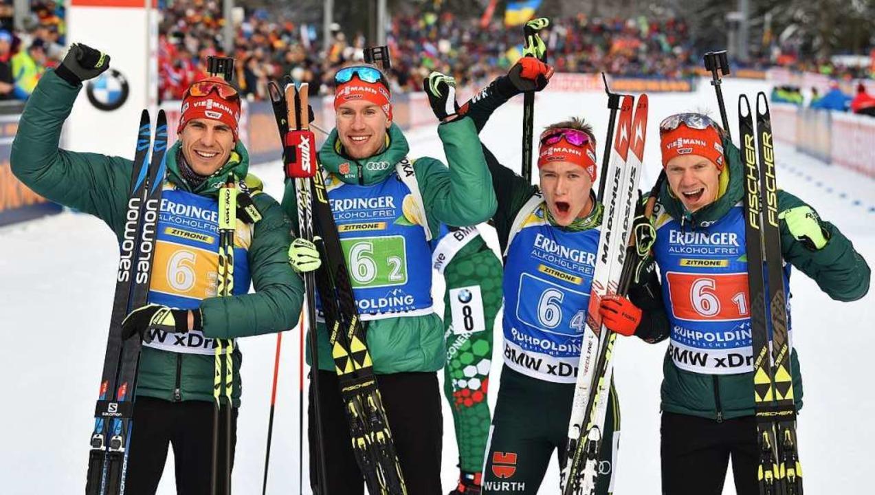 Die deutsche Männer-Biathlon-Staffel m...nes Kühn, Benedikt Doll und Roman Rees  | Foto: AFP