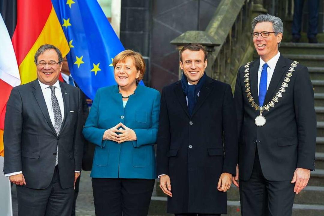 Armin Laschet, Angela Merkel, Emmanuel...d Aachens Bürgermeister Marcel Philipp  | Foto: AFP