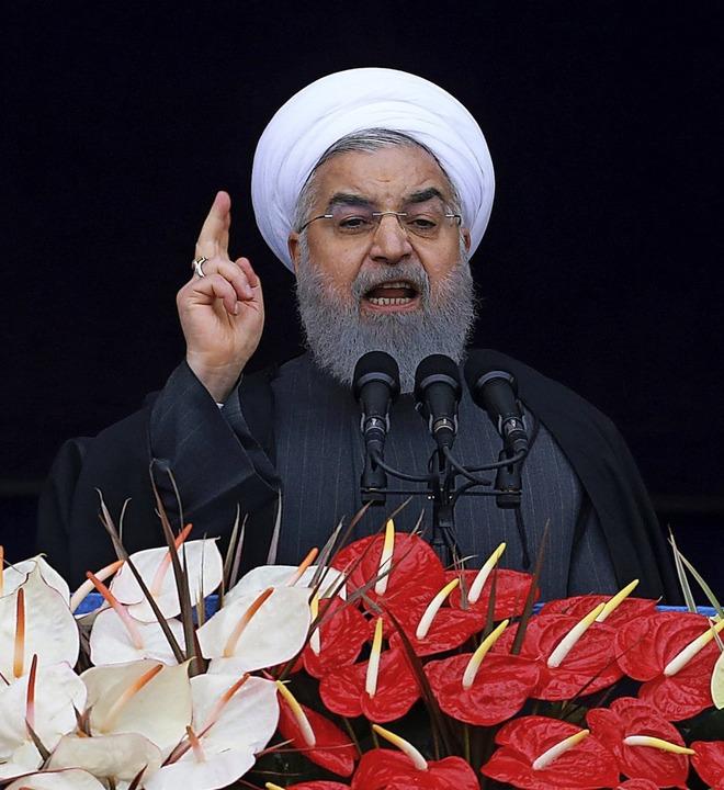 Präsident Hassan Ruhani kündigt zum Ja...ren an, sein Land weiter aufzurüsten.   | Foto: DPA