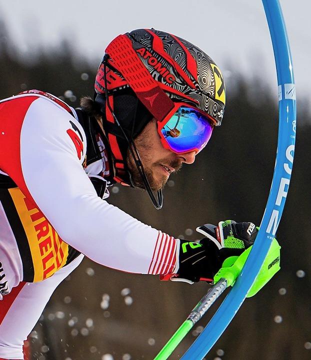 Künstler zwischen den Stangen: Der Öst...ikanische Ski-Königen Mikaela Shiffrin    Foto: afp/dpa
