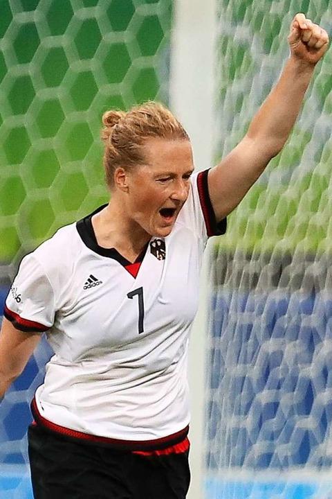 Nationalspielerin Melanie Behringer ju...ova Arena Stadium ein Tor erzielt hat.  | Foto: dpa