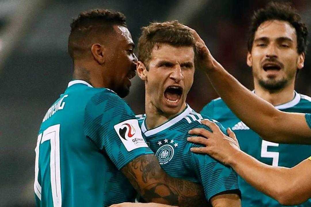 Jerome Boateng, Thomas Müller und Mats Hummels (von links)    Foto: AFP