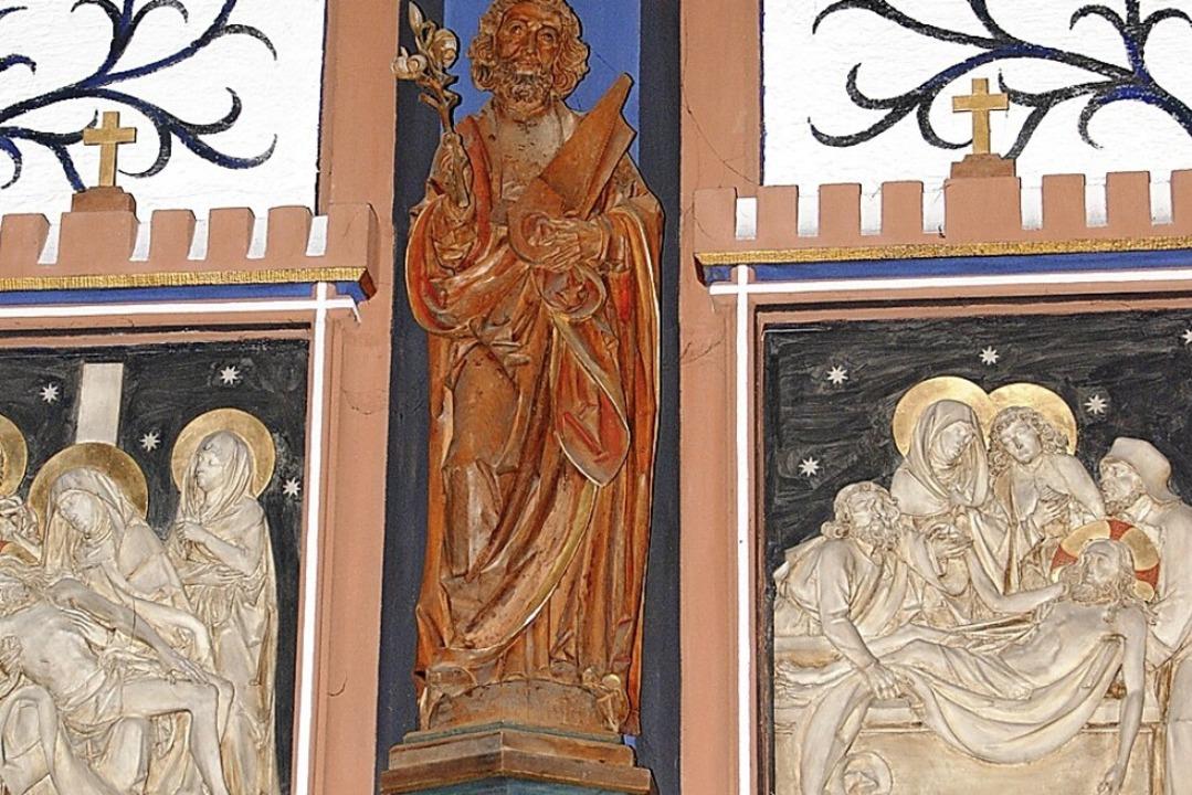 In der Kirche St. Georg in Ehrenstette... zwischen Kreuzwegstationen platziert.  | Foto: Manfred Frietsch