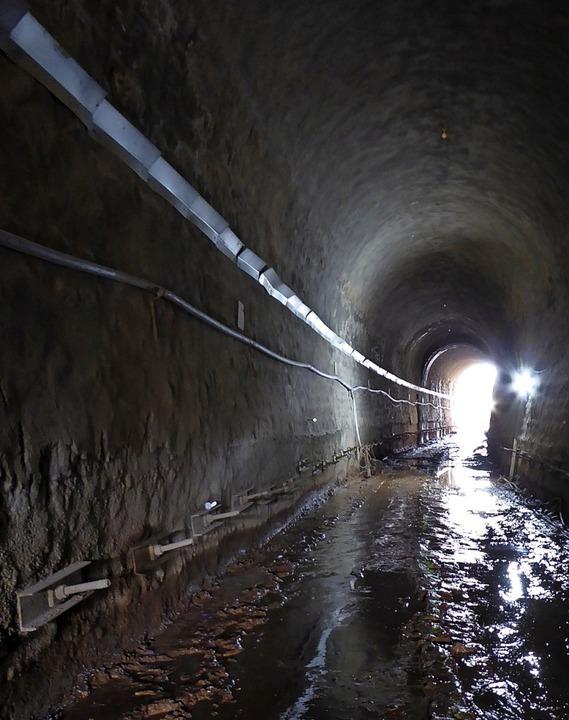 Arbeitsplatz Tunnelbaustelle: Schlamm   und Wasser drinnen und draußen  | Foto: Peter Stellmach