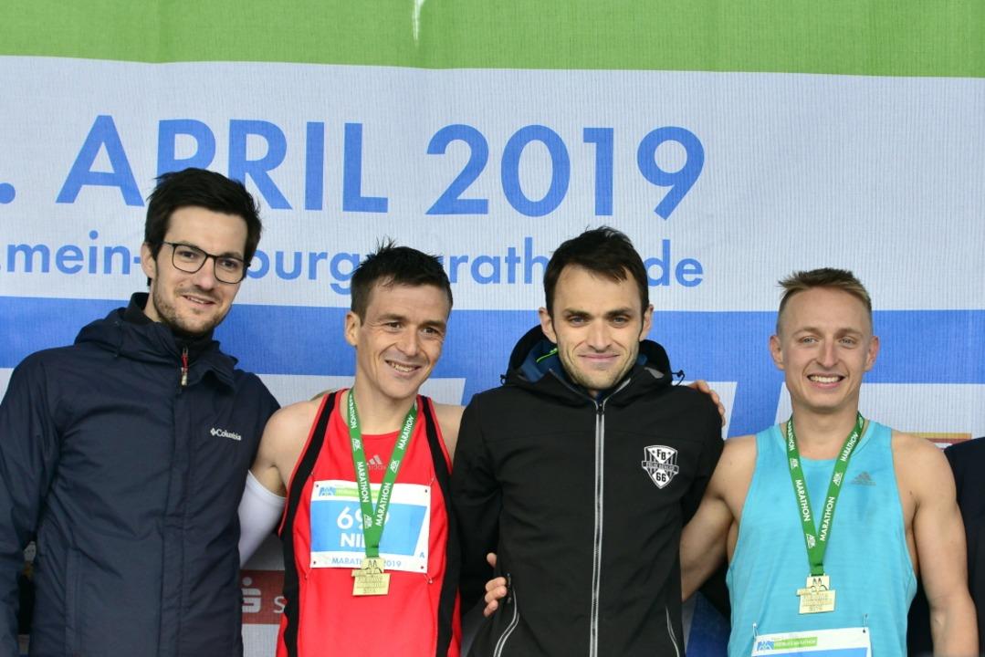 Siegerehrung mit Oberbürgermeister Mar...  Romaric Communod und Philipp Sassie.  | Foto: Daniel Thoma