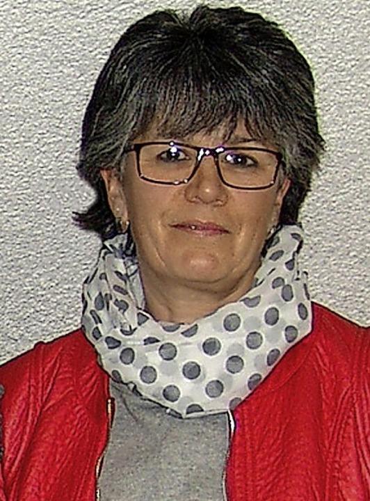 Für 25 Blutspenden wurde Ilona Brender von Bürgermeister Kreutz geehrt.   | Foto: Heinrich Fehrenbach