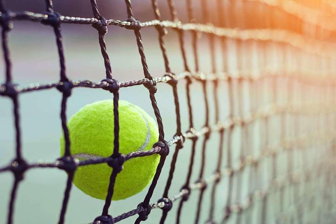 Beim Tennis soll der Ball ins gegneris... und nicht ins Netz geschlagen werden.  | Foto: WK Stock Photo - stock.adobe.com