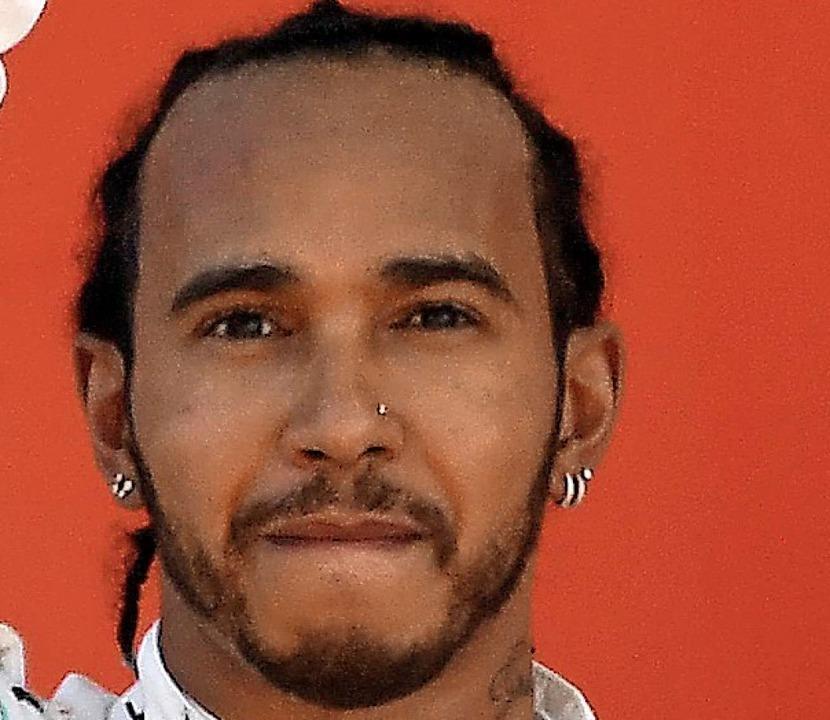 Der neue WM-Spitzenreiter Lewis Hamilton     Foto: Lluis Gene (AFP)