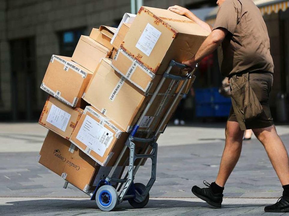 Die Spitzen von Union und SPD haben si...tsbedingungen von Paketboten geeinigt.  | Foto: dpa