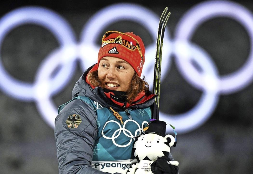 Höhepunkt ihrer Karriere: 2018 in Südk...Laura Dahlmeier zweimal Olympia-Gold.   | Foto: Franck fife (afp)