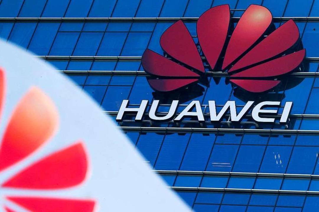 Huawei – mittendrin im Handelskonflikt zwischen China und den USA.  | Foto: Andy Wong (dpa)