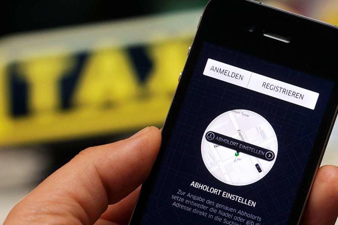 Unternehmen wie Uber nutzen Smartphone...en Vermittlung von Transportaufträgen.  | Foto: Jens Büttner