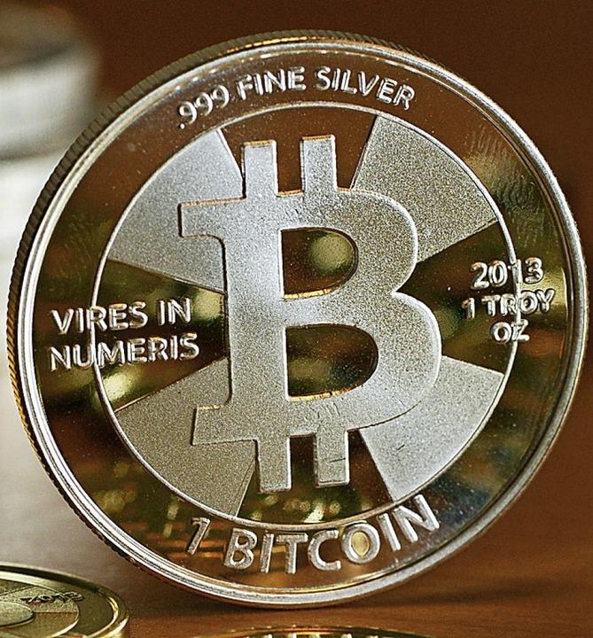 Bitcoin-Münze   | Foto: Jens Kalaene (dpa)