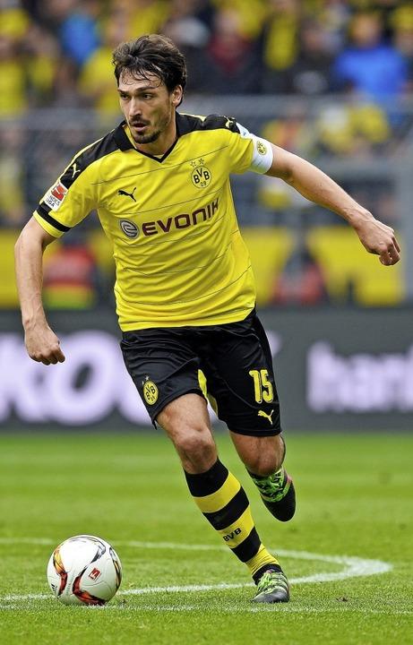Zurück ins schwarz-gelbe Textil: Ex-Bayern-Spieler Mats Hummels  | Foto: SASCHA SCHURMANN (AFP)