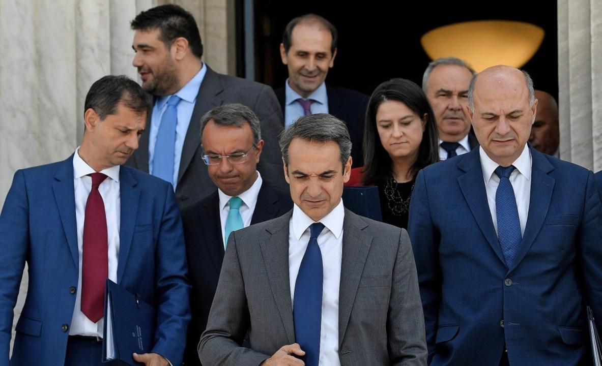 Selten dürfte ein neuer griechischer P... sein wie Kyriakos Mitsotakis (Mitte).    Foto: LOUISA GOULIAMAKI (AFP)