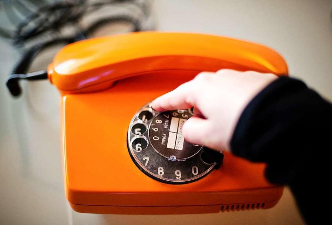 Ein altes Telefon mit einer Wählscheibe.  | Foto: Jan-Philipp Strobel