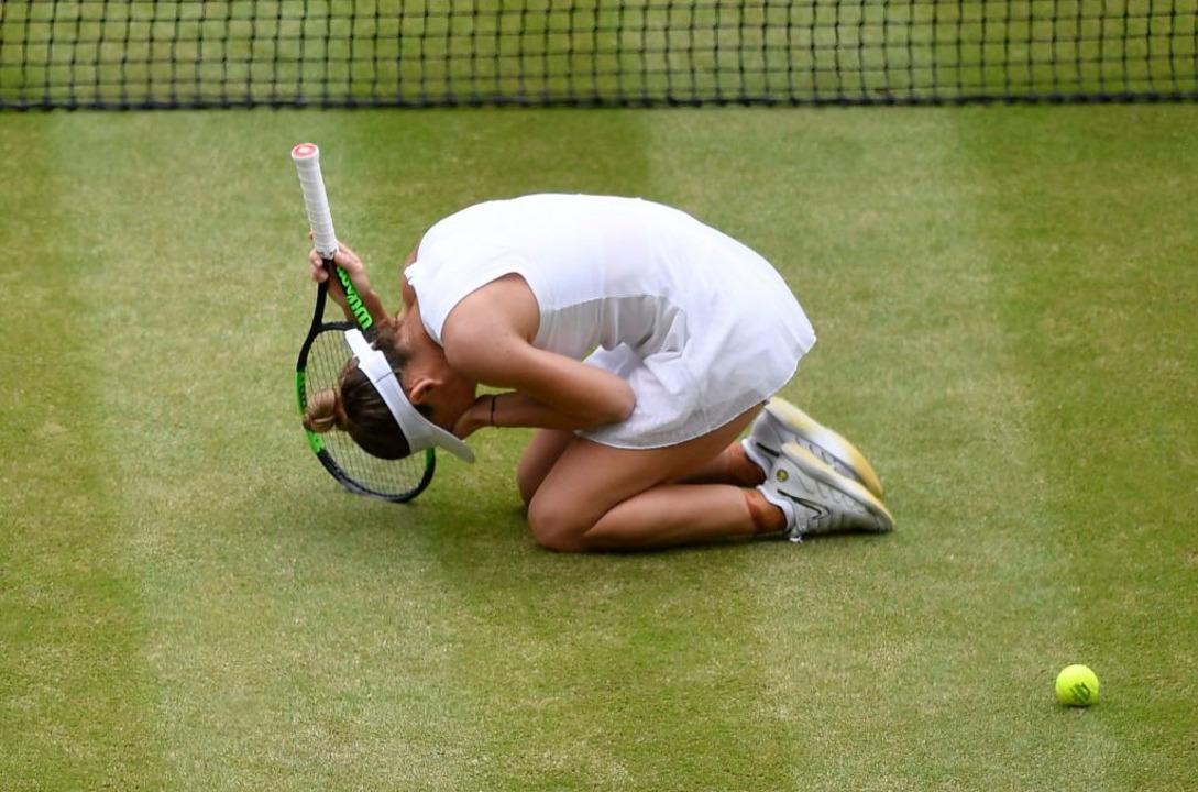 Simona Halep kann ihr Glück noch gar nicht fassen.  | Foto: TOBY MELVILLE (AFP)