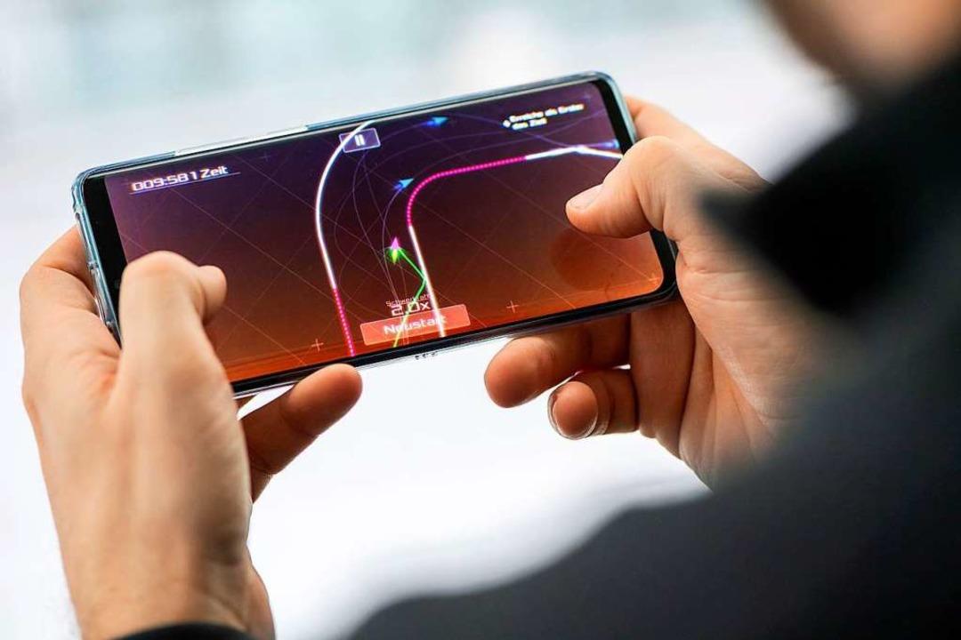 Die Nummer eins unter den Gaming-Platt...nschen hierzulande auf dem Smartphone.  | Foto: Andrea Warnecke (dpa)