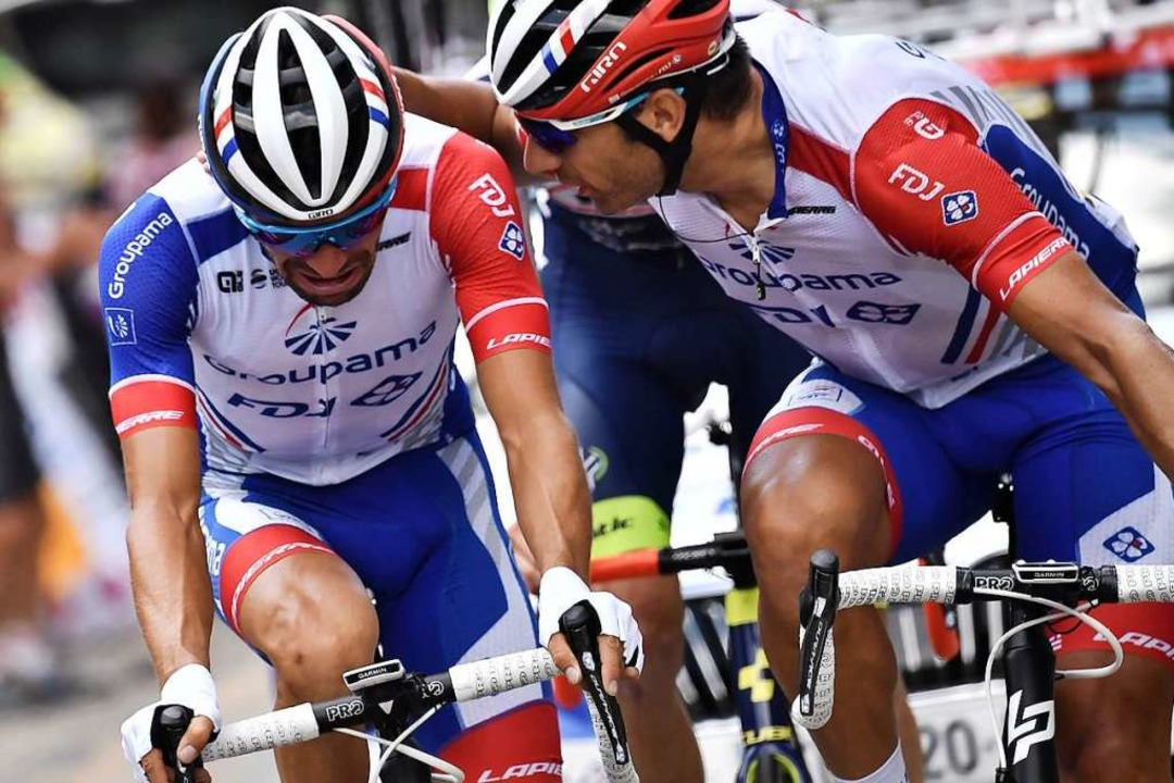 Wenn Männer weinen: Frankreichs Mitfav...ot (links) musste das Rennen aufgeben.  | Foto: MARCO BERTORELLO (AFP)