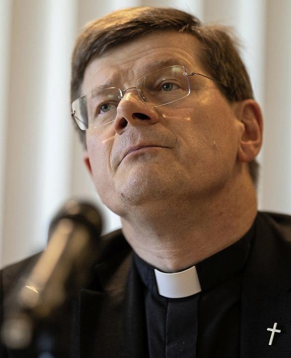 Die von  Erzbischof Stephan Burger ein...at ihren Zwischenbericht vorgestellt.   | Foto: Patrick Seeger (dpa)