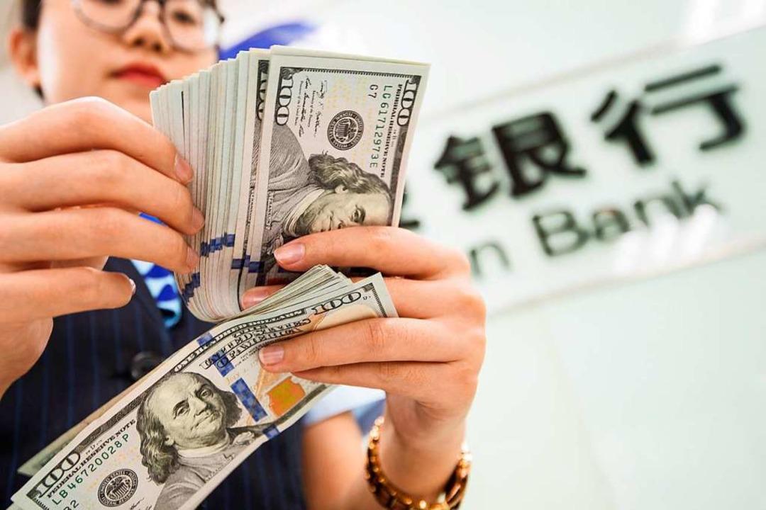 Wie entwickelt sich der Handelskrieg?    Foto: STR (AFP)