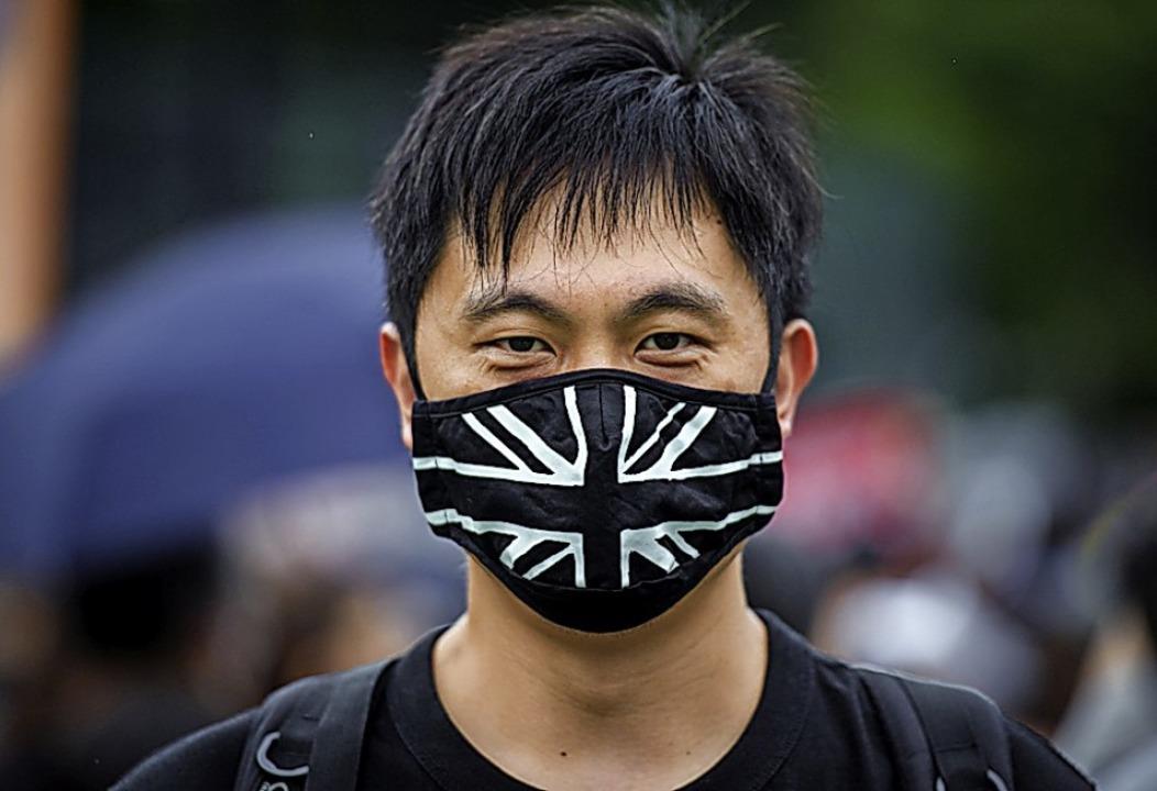 Ein Demonstrant am Sonntag in Hongkong    Foto: Gregor Fischer (dpa)