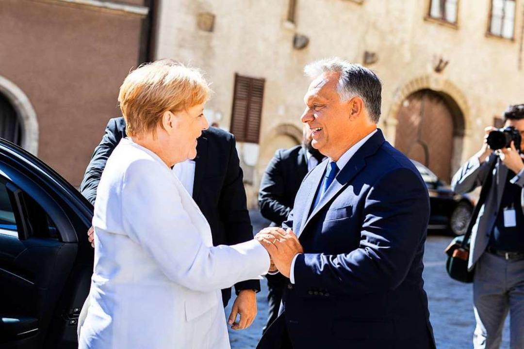 Angela Merkel und Viktor Orban  | Foto: Balazs Szecsodi (dpa)