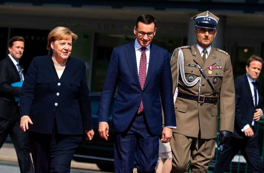Bundeskanzlerin Angela Merkel (CDU) un...ag des Beginns des Zweiten Weltkriegs.  | Foto: Bernd von Jutrczenka (dpa)