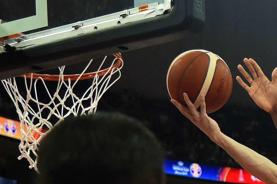 Der Weiler TV und der Lörracher CVJM s...Basketball-Grundschulliga (Symbolbild)  | Foto: HECTOR RETAMAL (AFP)