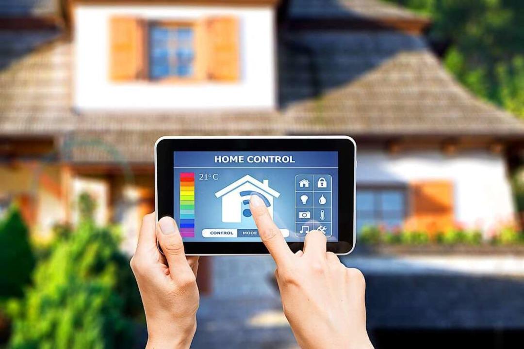 Das gehört zu einem Smart Home: Fenste... Tablet oder ein Smartphone gesteuert.  | Foto: Artur Marciniec - Fotolia