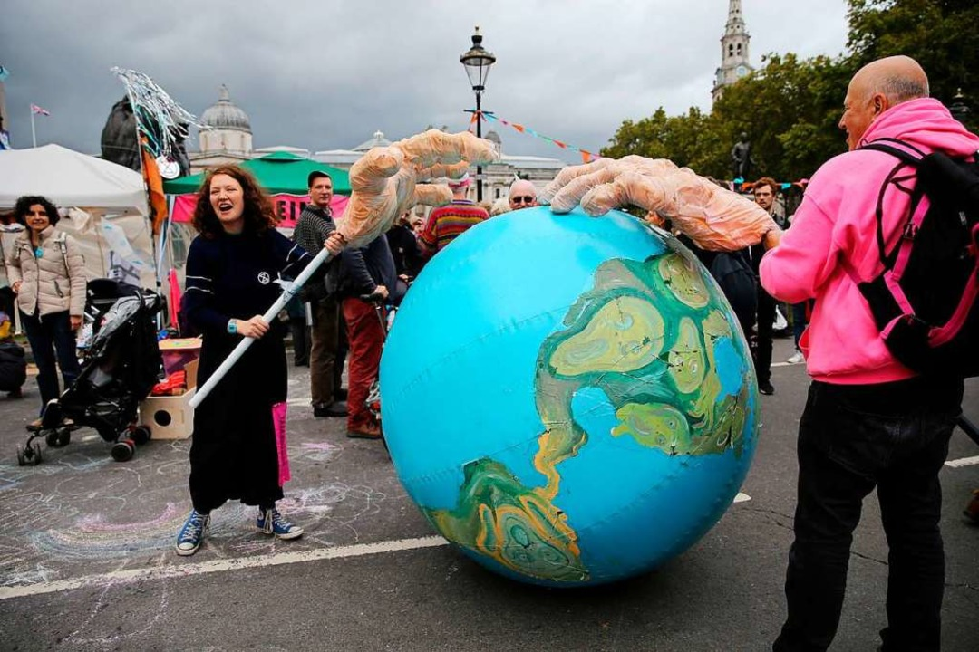 Klimaschützer protestieren in London.  | Foto: ISABEL INFANTES (AFP)