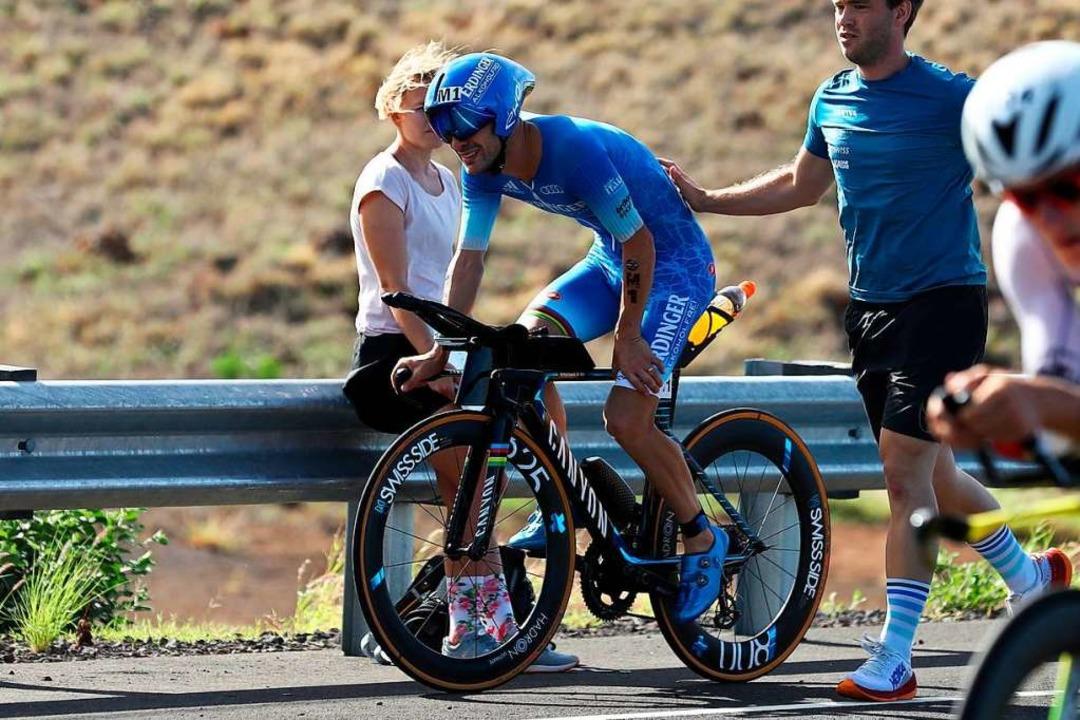 Patrick Lange, hier noch auf dem Rennr...das Rennen später entkräftet aufgeben.  | Foto: David Pintens (dpa)