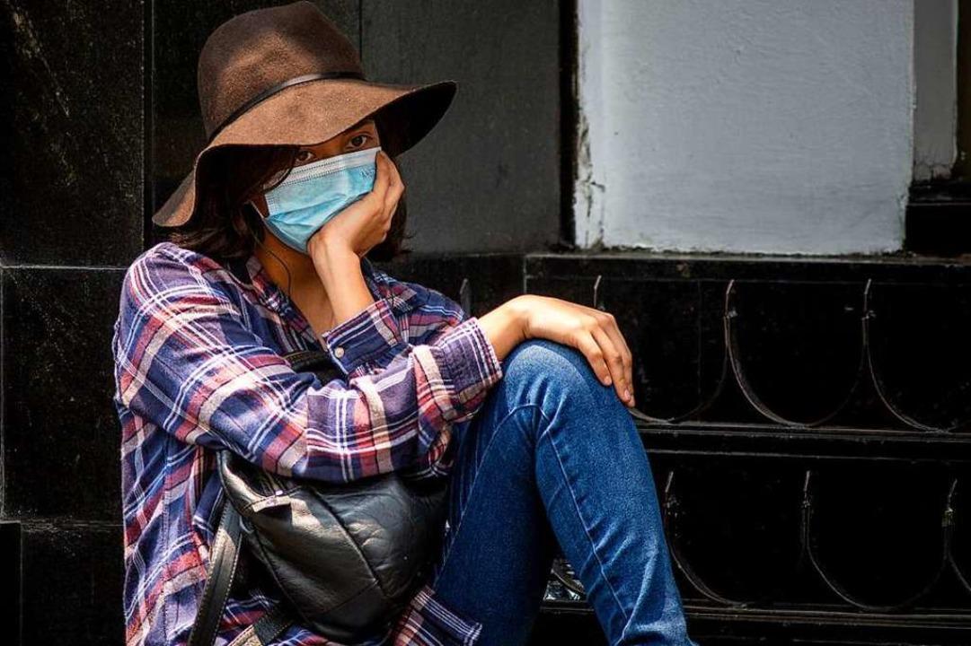 Mit dem Mundschutz gegen Luftverschmutzung?  | Foto: Jair Cabrera Torres (dpa)